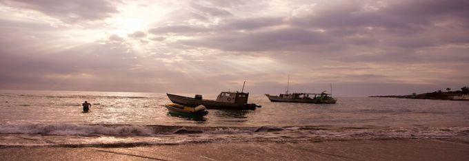 3 boats at a beach